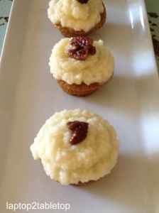 pumpkin cupcake with maple frosting and maple-glazed pecans